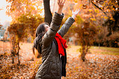 Beautiful young girl have fun in autumn park