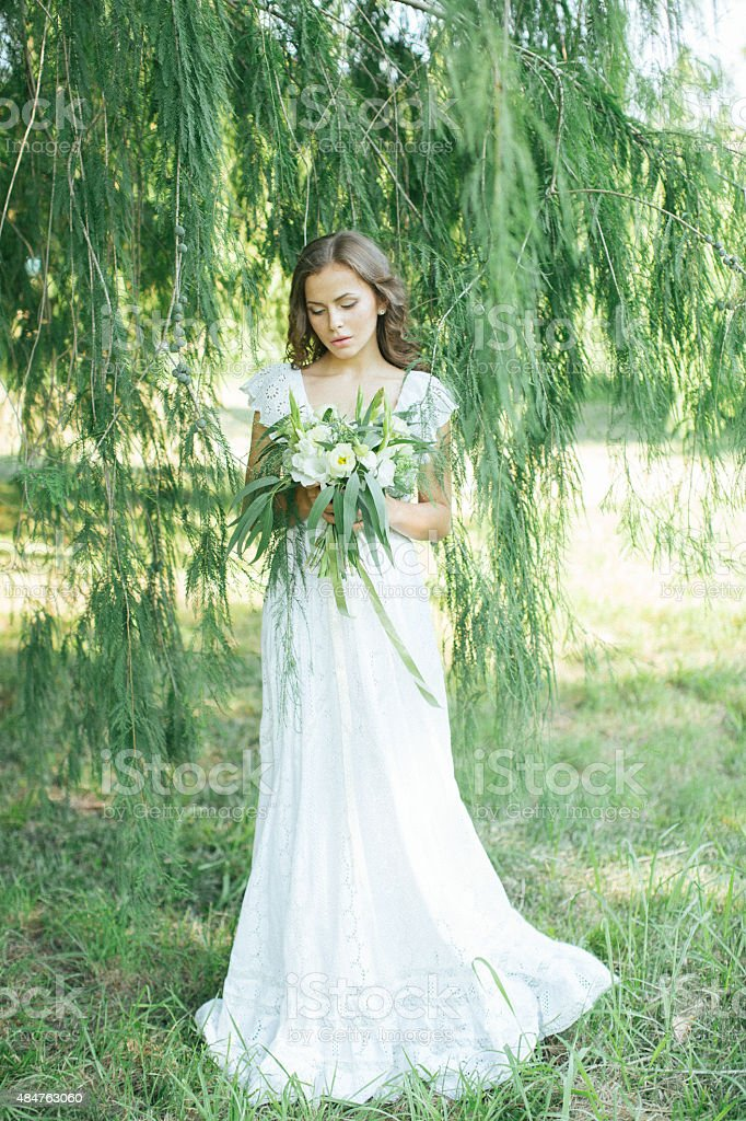 Beautiful young girl holding a bouquet stock photo