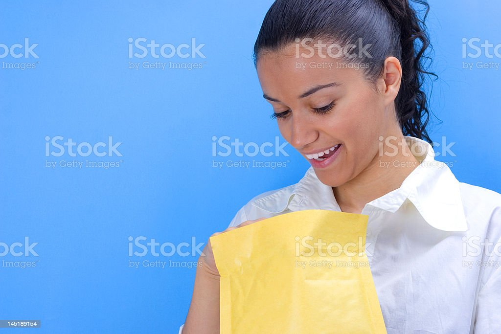 beautiful young girl holding envelope in her hands royalty-free stock photo