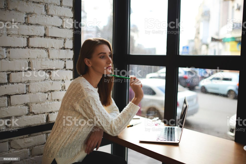 Beautiful young girl in a light sweater stock photo