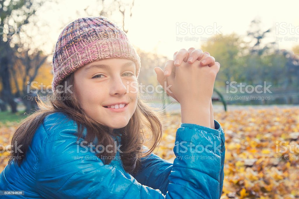 Beautiful young girl in a park stock photo