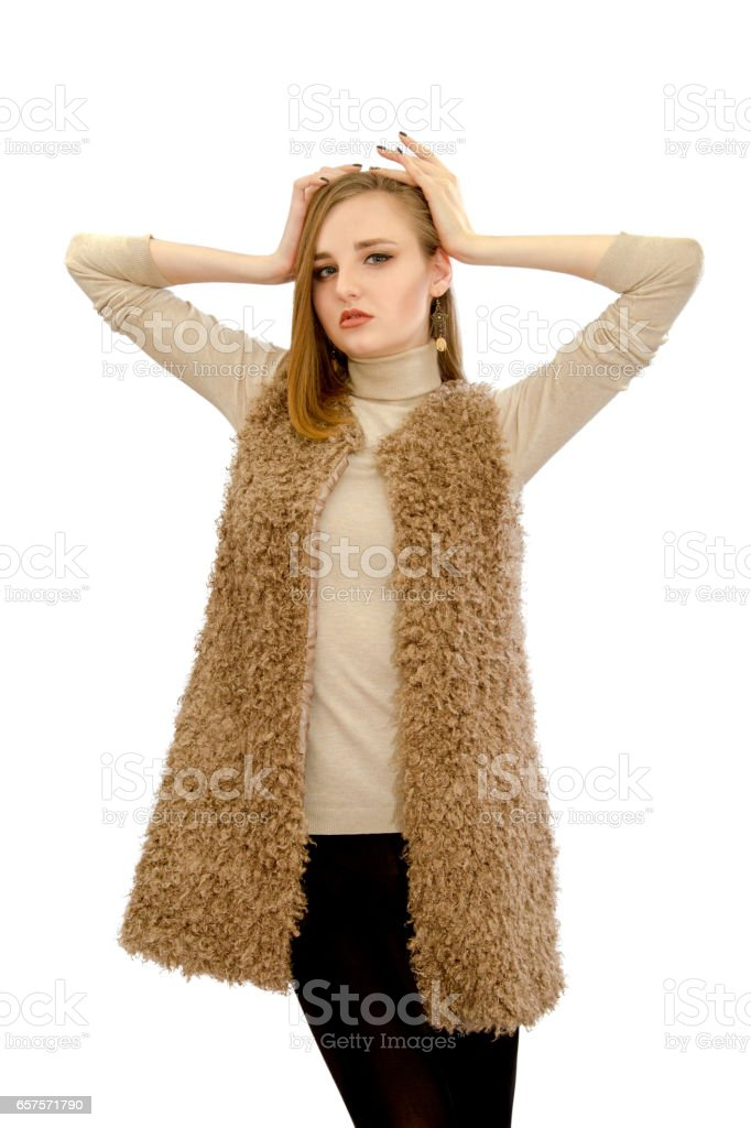 beautiful young girl in a vest an artificial fur stock photo