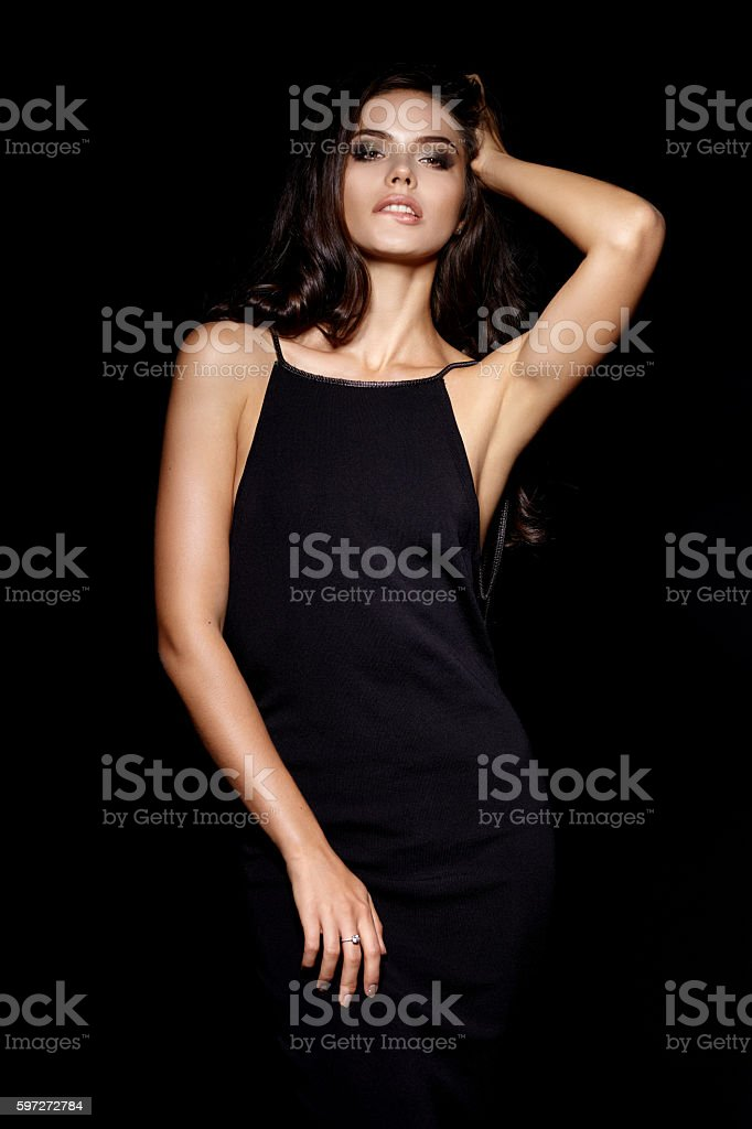 Beautiful young girl in black dress stock photo