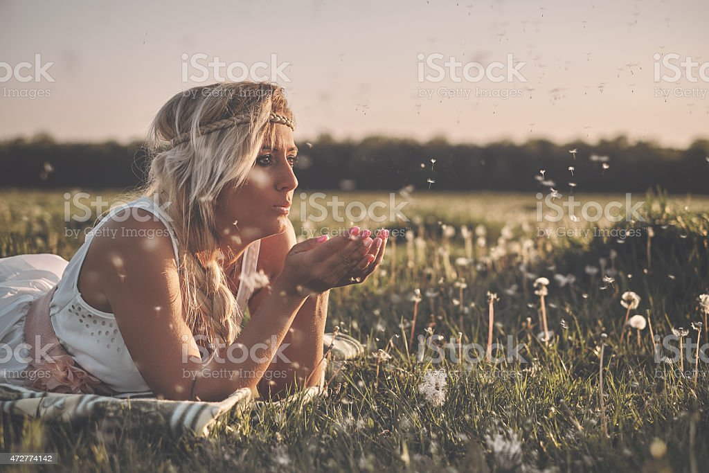 Beautiful young girl in dress on the spring meadow stock photo