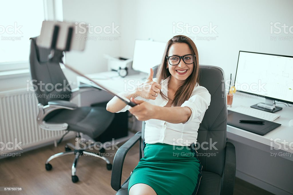 Beautiful young girl in office stock photo