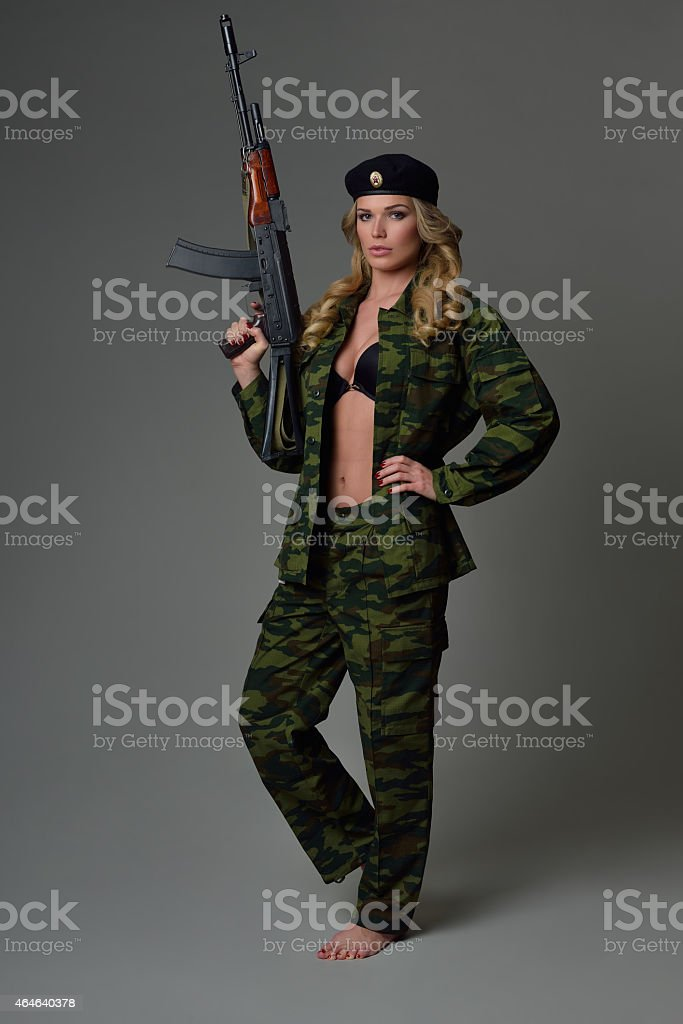 Beautiful young girl in old russian uniform stock photo