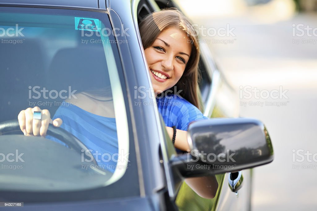 Beautiful young girl in the car. royalty-free stock photo