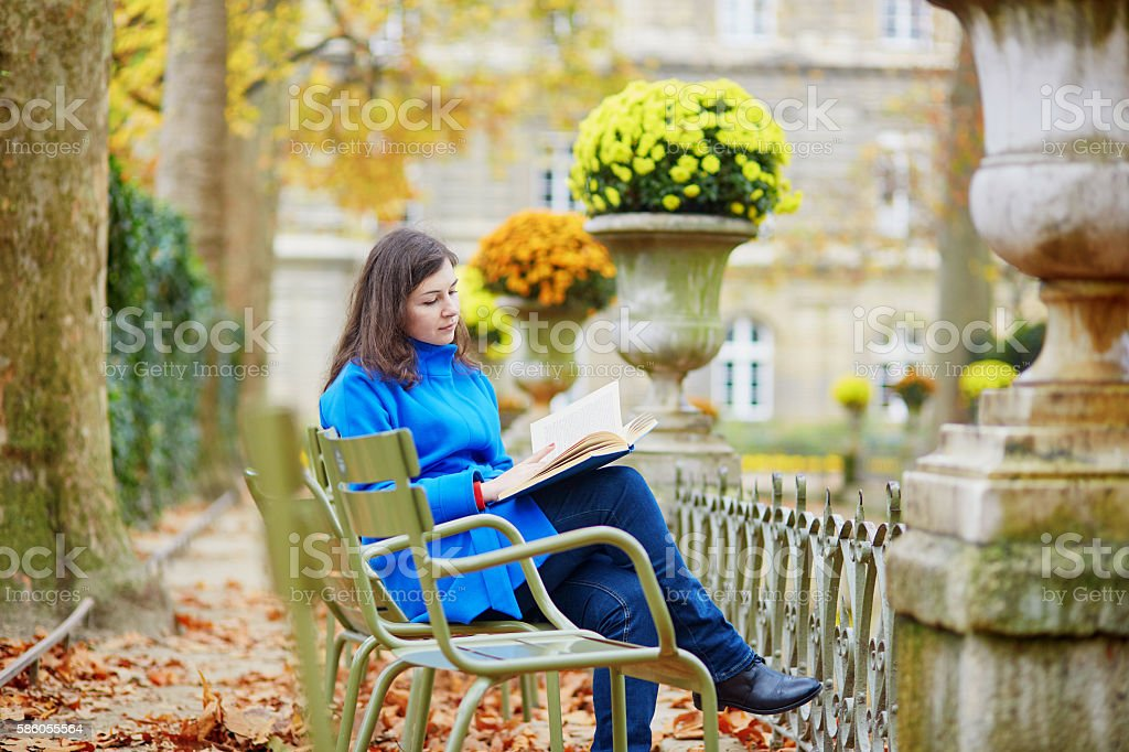 Beautiful young girl in the Luxembourg garden of Paris stock photo