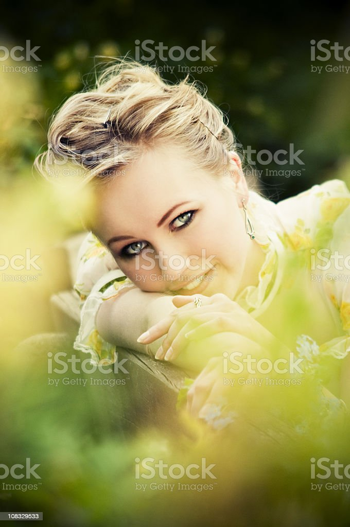 beautiful young girl in the park royalty-free stock photo