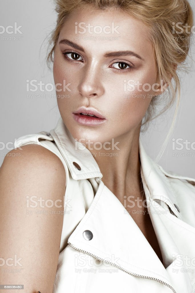 Beautiful young girl in white dress with a light natural stock photo