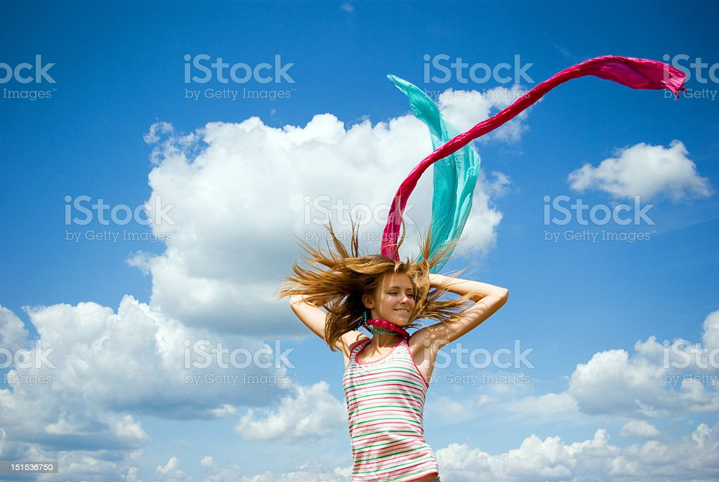 Beautiful young girl jumping in a sunny day royalty-free stock photo