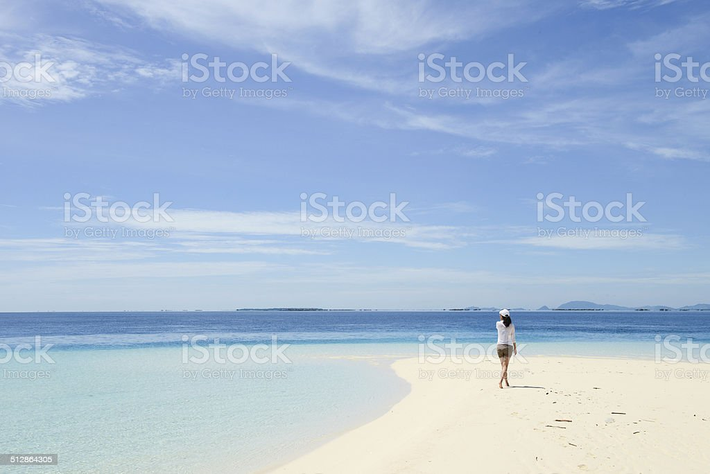 beautiful young girl looking at horizon on tropical beach royalty-free stock photo