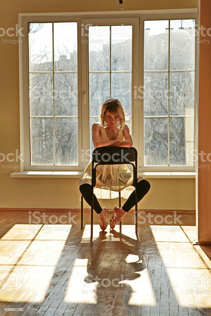 Beautiful young girl model  sit in room stock photo