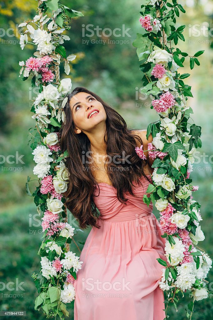 Beautiful young girl on a swing stock photo