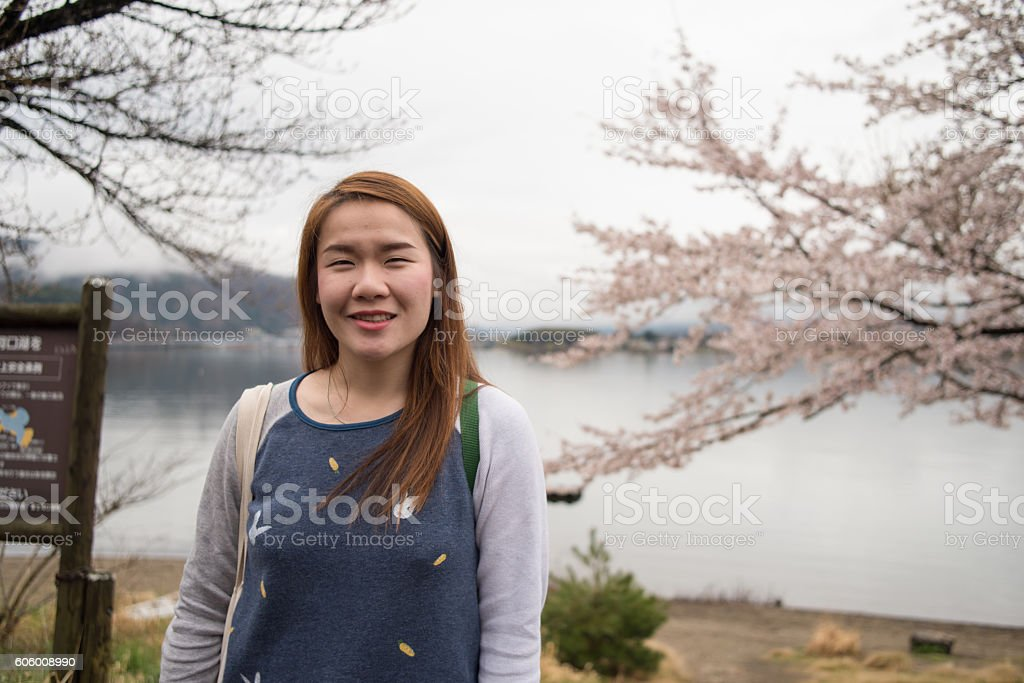 Beautiful young girl on background flowering apple-tree stock photo