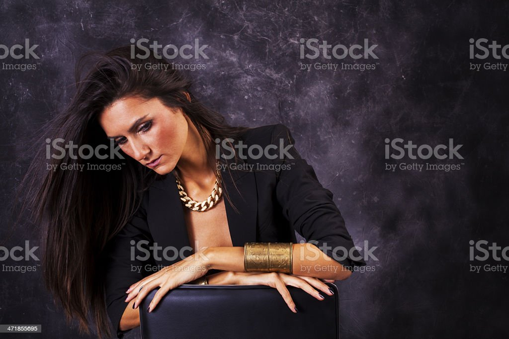 Beautiful young girl on gray background posing royalty-free stock photo