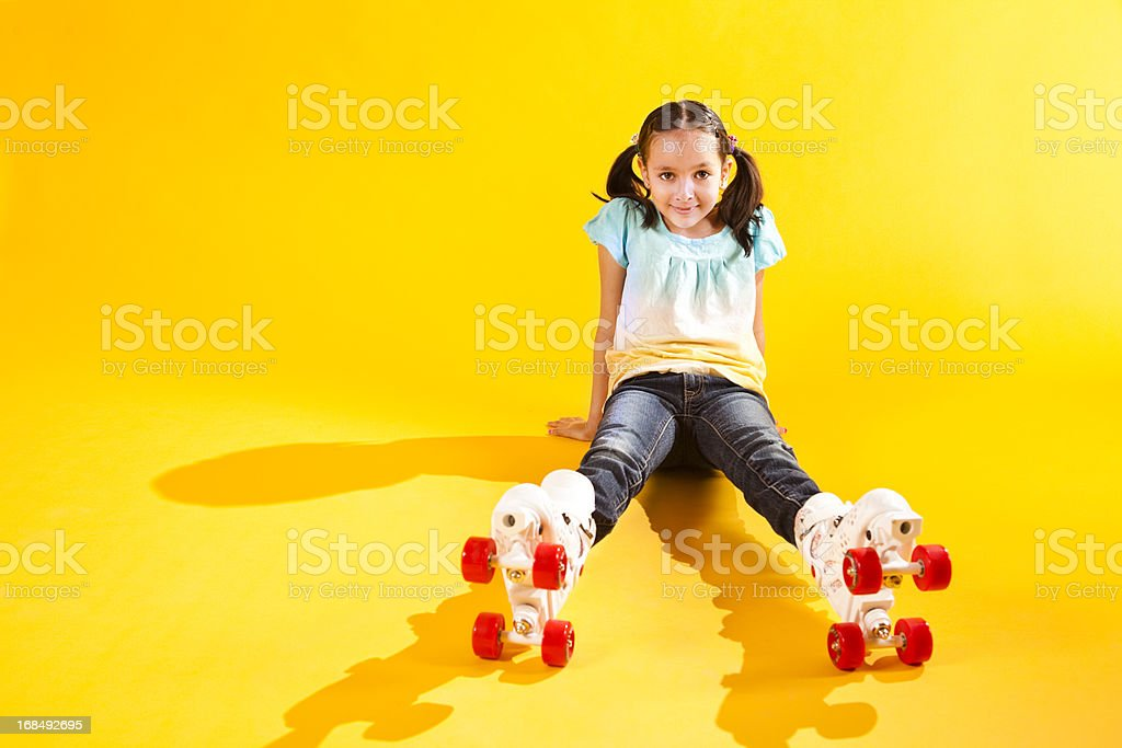 Beautiful Young Girl on Roller Skates stock photo