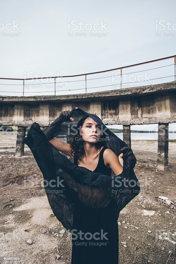 Beautiful young girl on the background of the dam stock photo