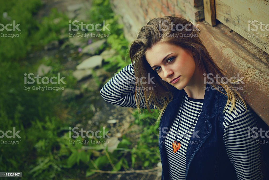 beautiful young girl outdoor in the thrown place royalty-free stock photo