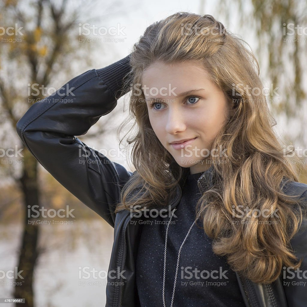Beautiful young girl outdoors stock photo