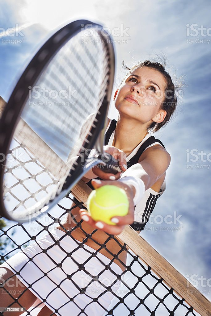 Beautiful young girl playing tennis royalty-free stock photo