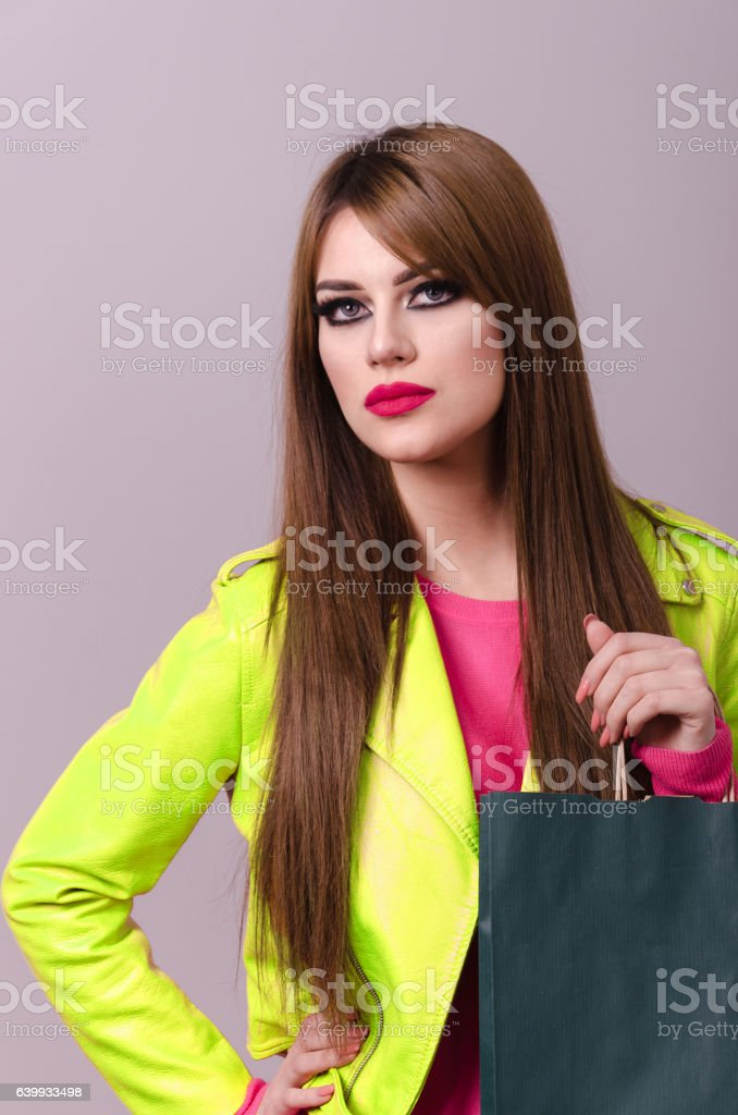 beautiful young girl poses in front of the camera stock photo