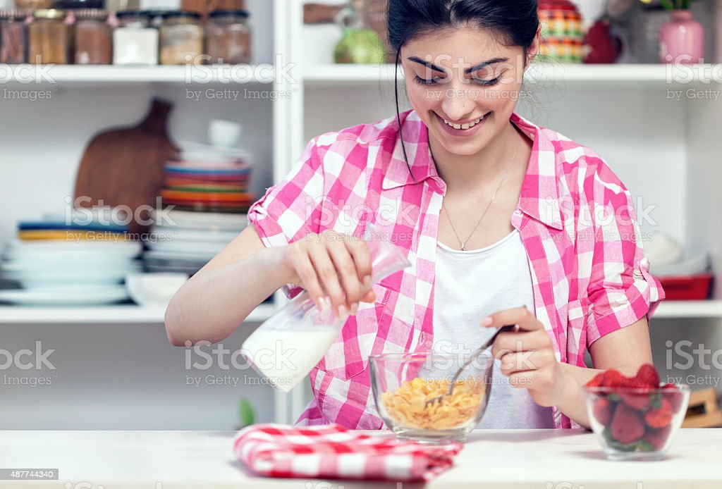 Beautiful Young Girl Preparing Healthy Breakfast stock photo