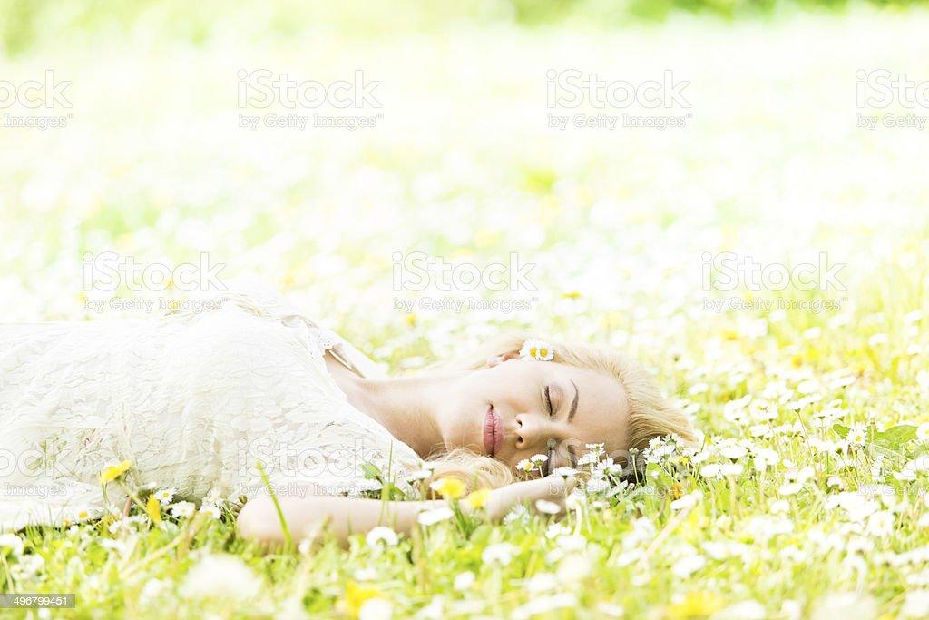 Beautiful young girl relaxing in nature stock photo