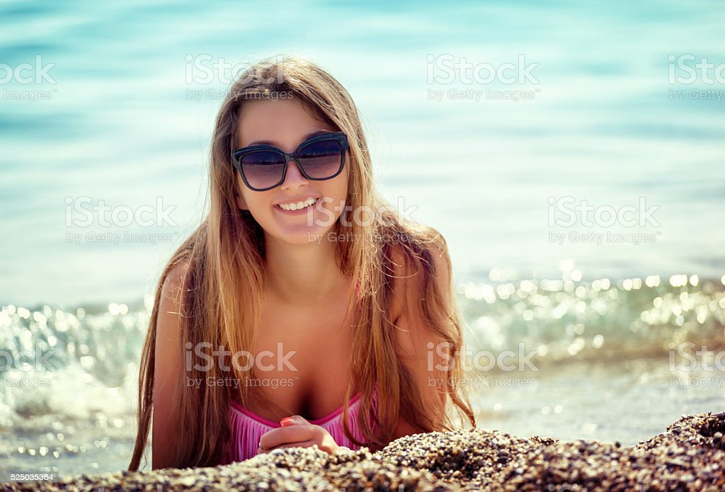 Beautiful Young Girl Relaxing on The Beach stock photo