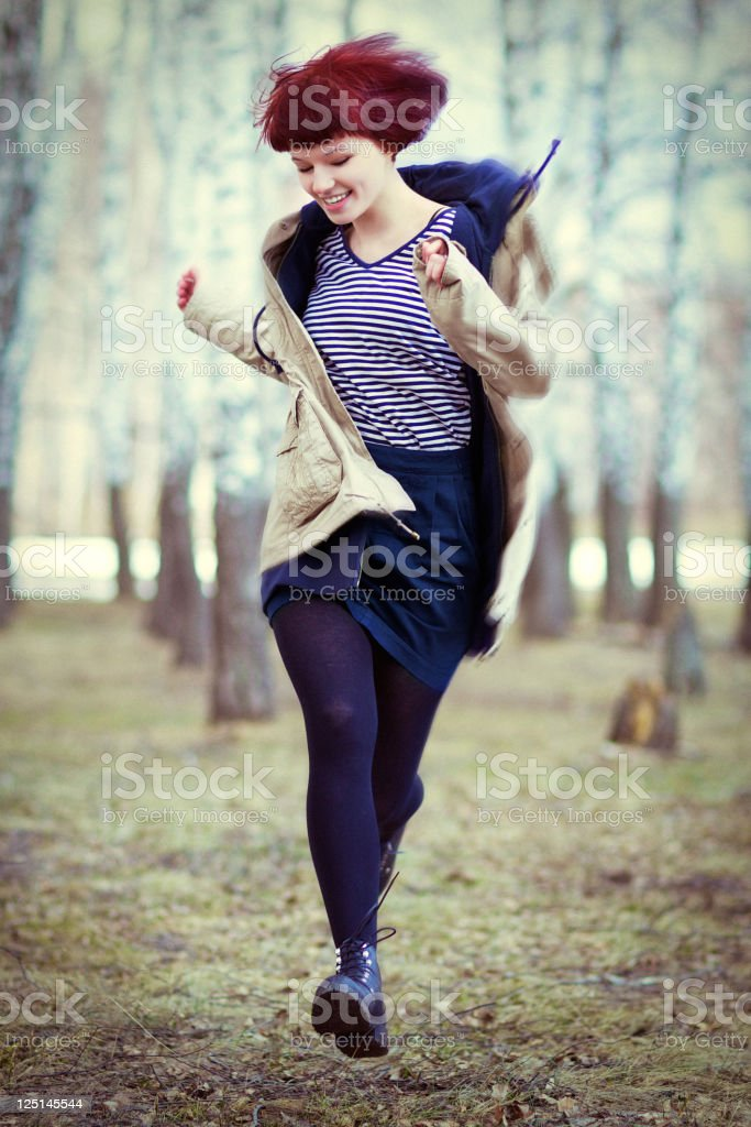 Beautiful young girl runs through the woods royalty-free stock photo