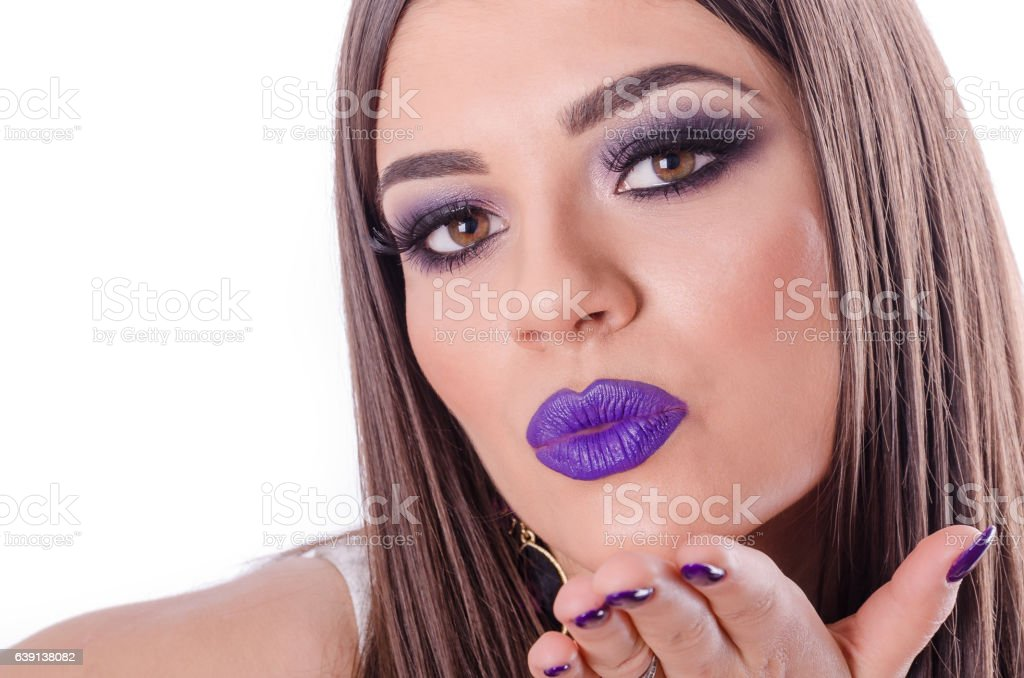 beautiful young girl sends a kiss with his hand Closeup stock photo