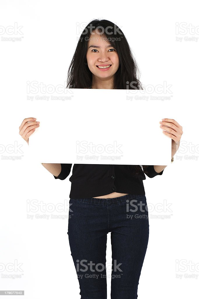 Beautiful young girl smiling holding blank card royalty-free stock photo