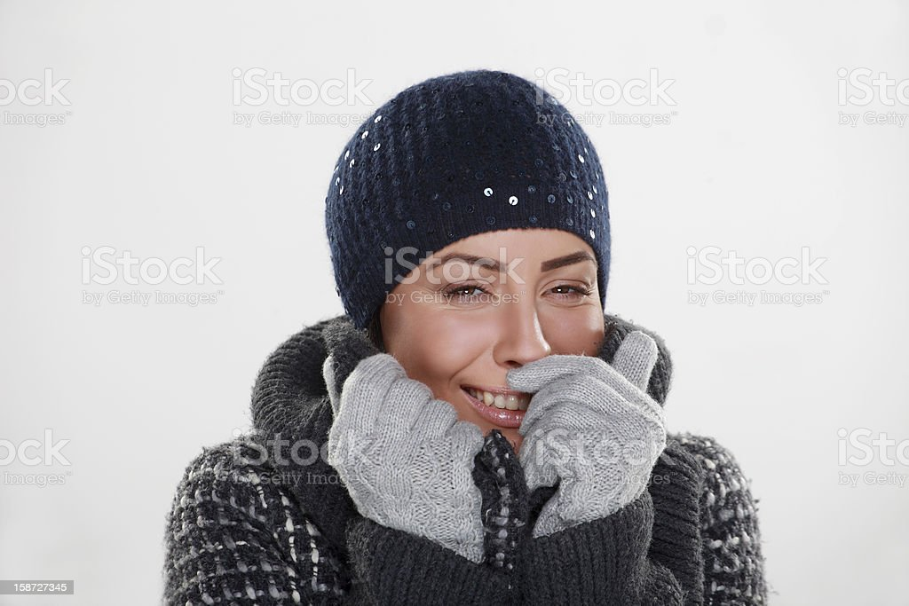 beautiful young girl smiling  with winter cap and gloves royalty-free stock photo