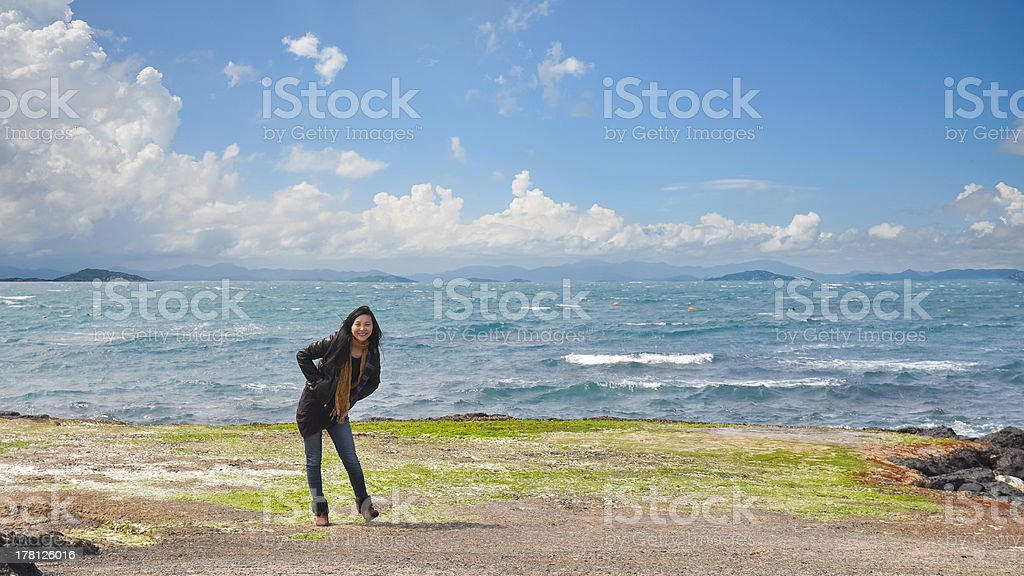 beautiful young girl standing before ocean royalty-free stock photo