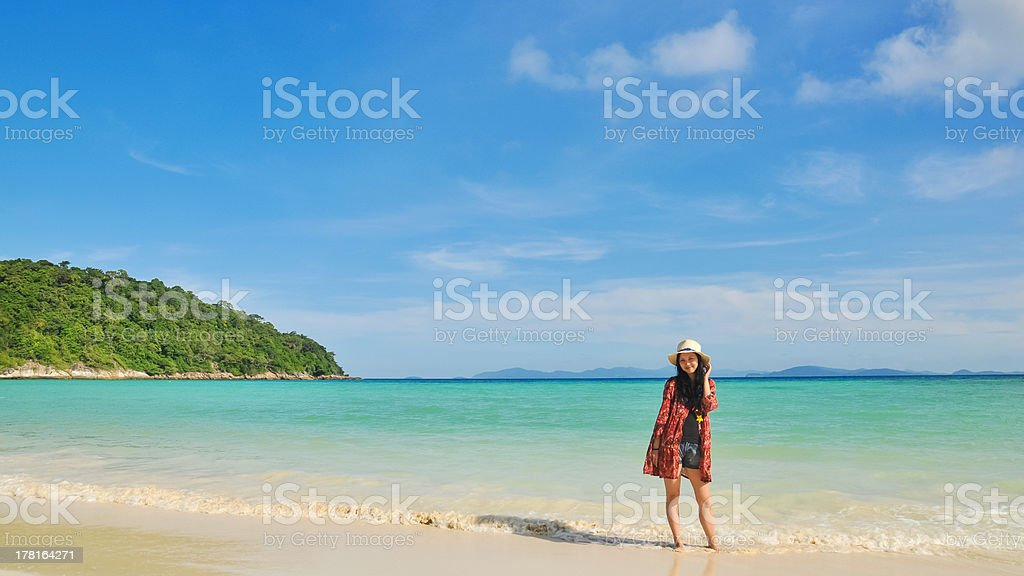 beautiful young girl standing on tropical beach royalty-free stock photo