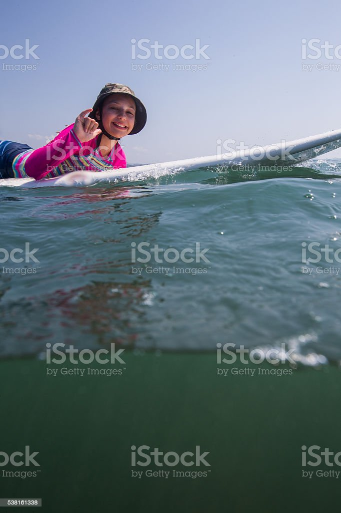 Beautiful young girl surfing stock photo
