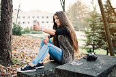 Beautiful young girl taking a selfie