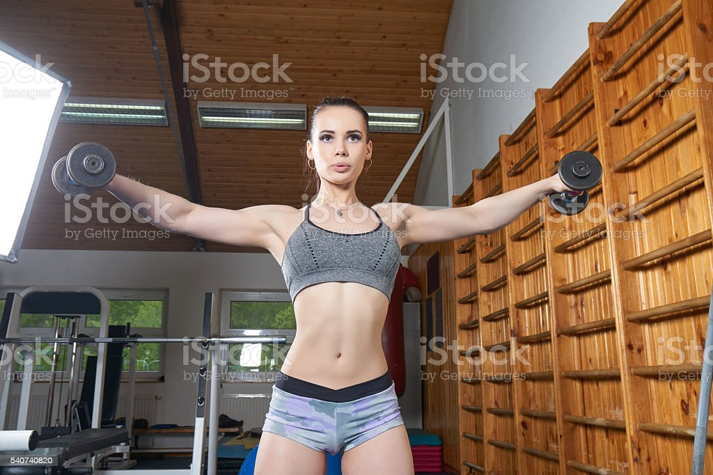 Beautiful young girl training stock photo