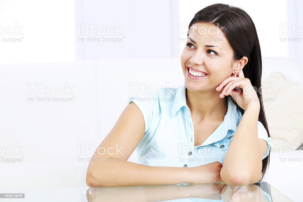 Beautiful  young girl viewed from the side and thinking royalty-free stock photo