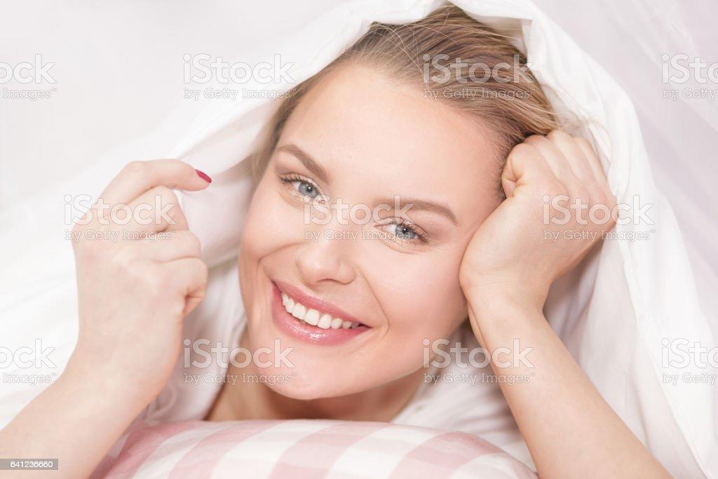 Beautiful young girl waking up. stock photo