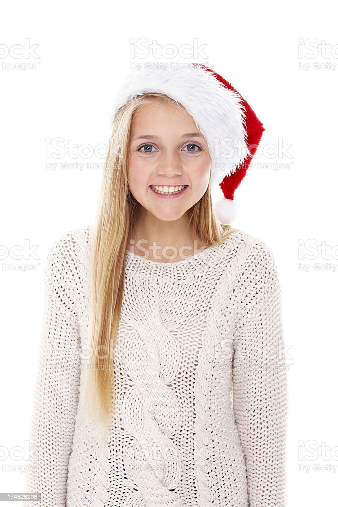Beautiful young girl wearing Santa hat smiling royalty-free stock photo