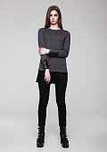 Beautiful young girl wearing shirt fashion on grey