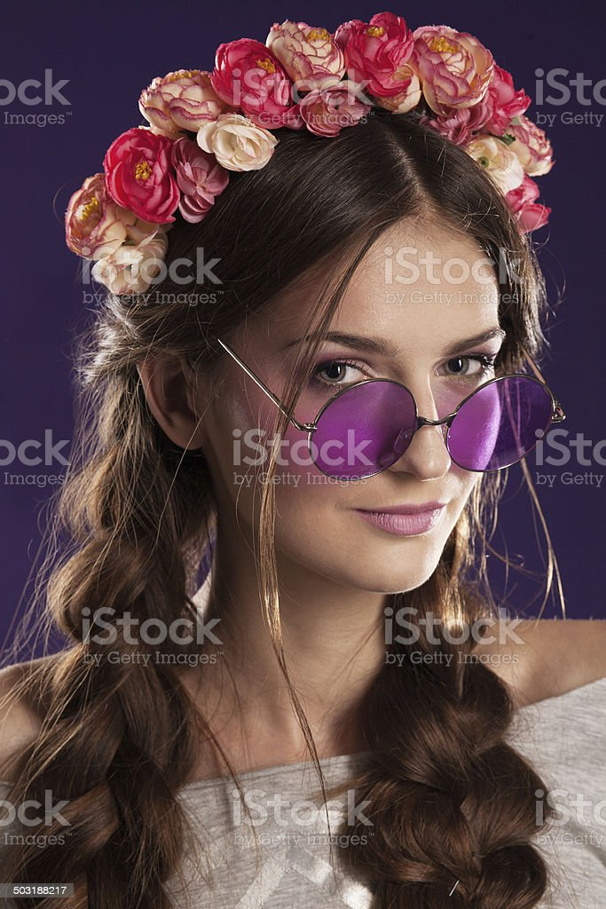 Beautiful young girl with a floral ornament in her hair stock photo
