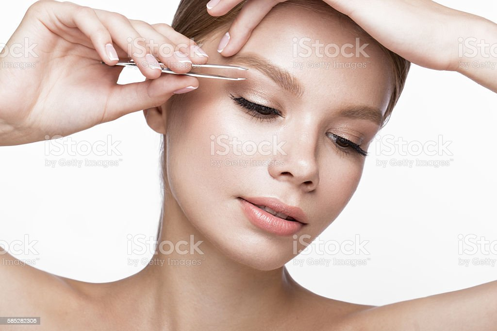 Beautiful young girl with a light natural make-up, Eyebrow stock photo
