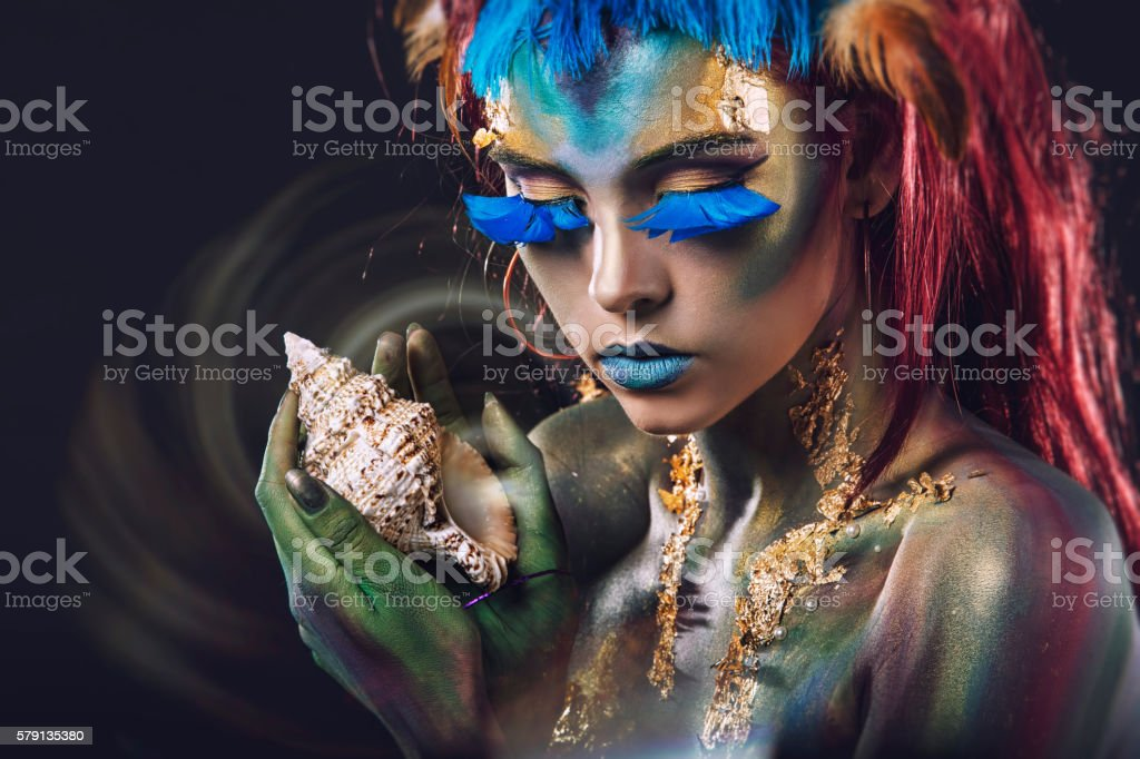 Beautiful young girl with body art in an  fantasy style stock photo