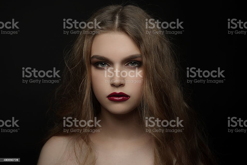 Beautiful young girl with fashion make-up, natural hair, red lips stock photo