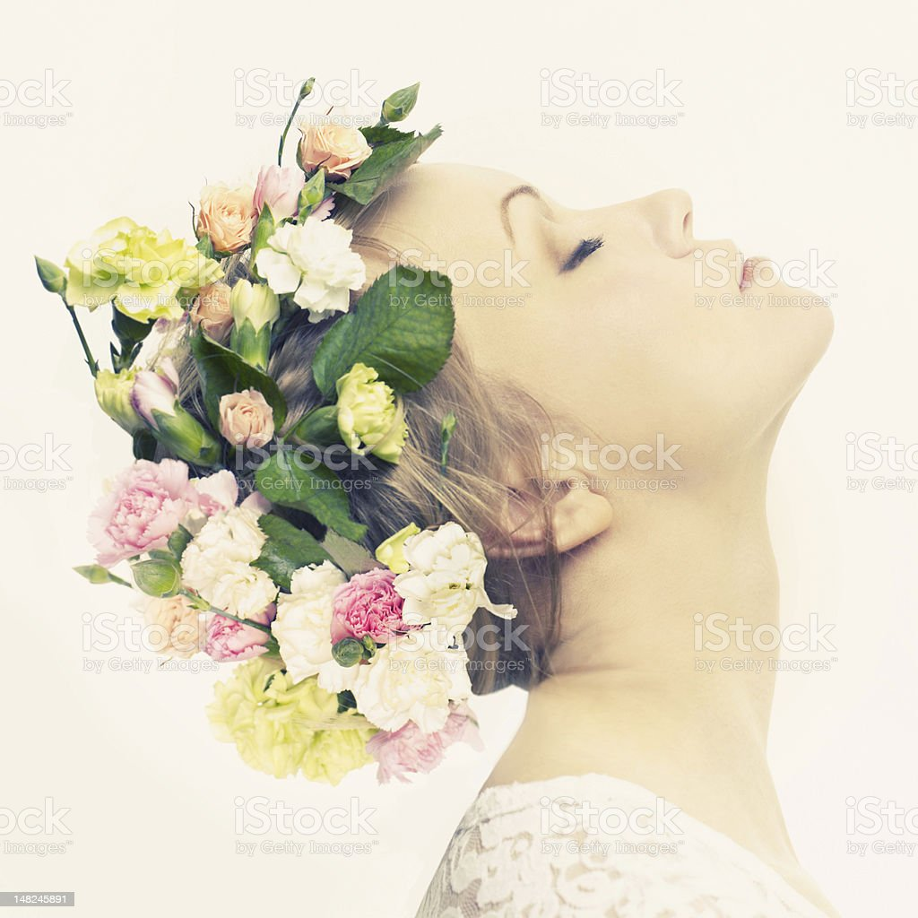 Beautiful young girl with flowers stock photo