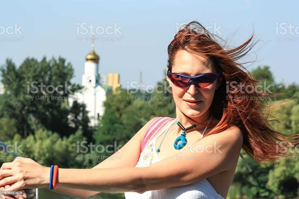 A beautiful young girl with flying red hair stock photo