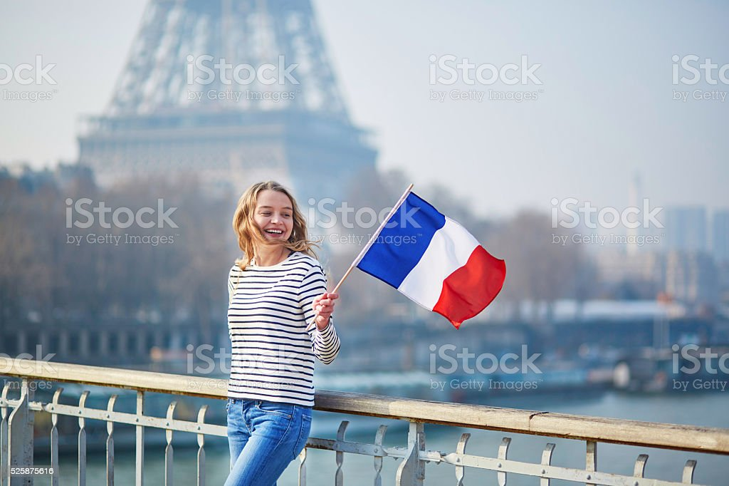 Beautiful young girl with French national flag stock photo