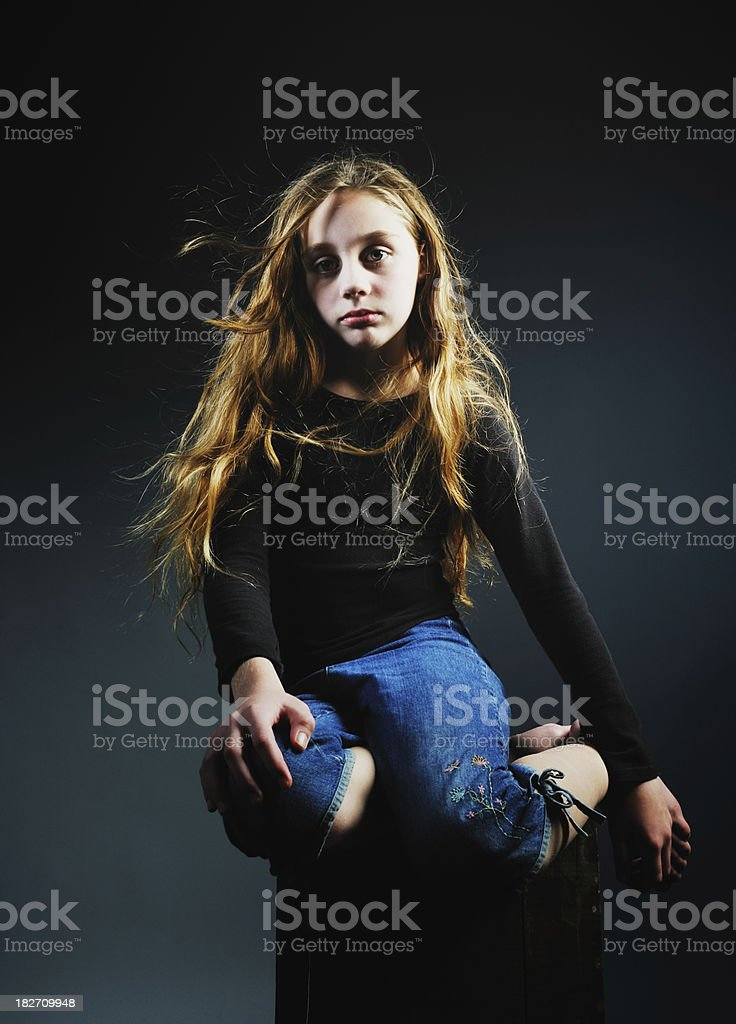 Beautiful young girl with intense gaze stock photo
